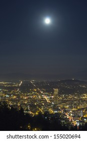 Harvest Full  Moon Rise Over Portland Oregon at Night with City Lights and Traffic Light Trails at Night