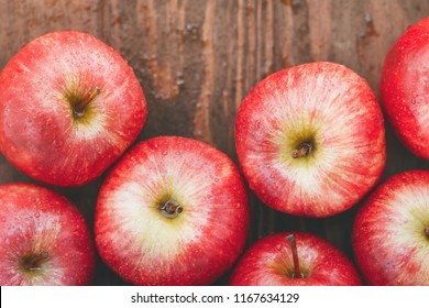 Harvest of ripe apples variety Red Delicious. Food background, top view, flat lay.