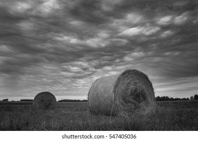 Harvest and stormy clouds