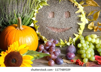 Harvest Thanksgiving autumn still life with happy sunflower  fruits and vegetables