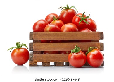 Harvest tomatoes in wooden box with green leaves. Vegetable still life. Healthy food organic food. Gardening and farming. Isolated on white background.