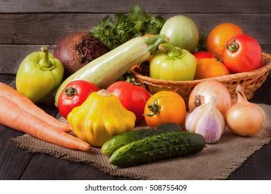 harvest of vegetables on a wooden background