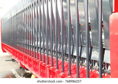Harvester of a combine harvester. Bottom view. There are chains and knives.