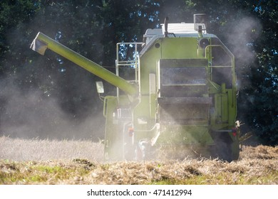 harvester on a wheat field