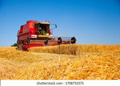 Harvester working in a wheat field.