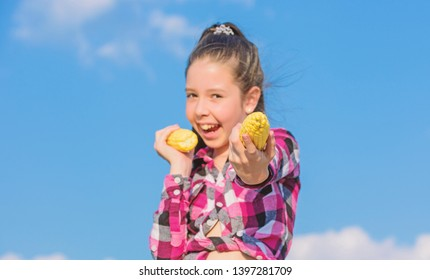 Harvesting and fun. Corn vegetarian and healthy organic product. Vegetarian nutrition concept. Kid girl hold yellow corn cob on sky background. Girl cheerful hold ripe corns. Kids love corn food.