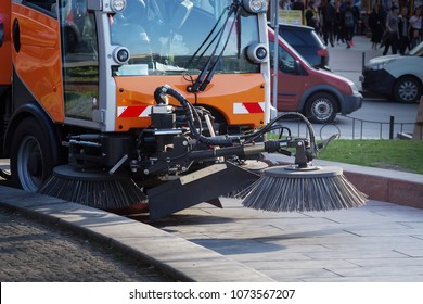 Harvesting machine in the process of cleaning the street. Cleaner in the street. Street cleaning. Municipal service cleans the city.