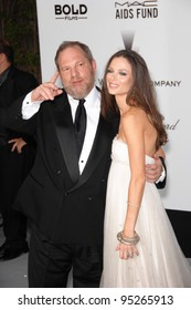 Harvey Weinstein & Georgina Chapman at amfAR's Cinema Against AIDS 2007 Gala at Le Moulin de Mougins restaurant just outside Cannes.  May 23, 2007  Cannes, France.  2007 Paul Smith / Featureflash