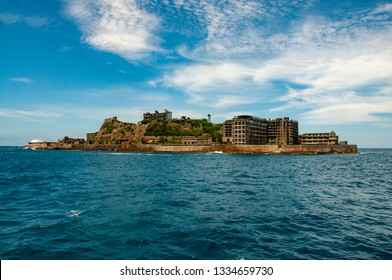 Hashima now known as Battleship Island due to it looking like the warship Tosa. It lies south west of Nagasaki harbour and was a busy coal mine and at its peak had a population of around 5,300.