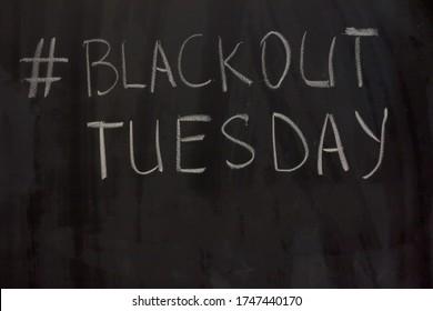 hashtag Blackout Tuesday on the blackboard background