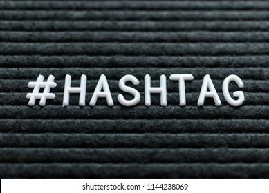 Hashtag word # hashtag written on the letter board. White letters on the black background.