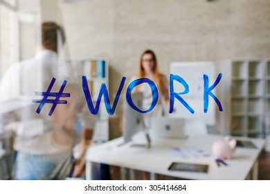 Hashtag for work on transparent board in office