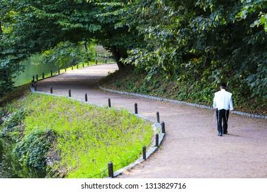 Hasidic Jew in  kippah walk in the park in Uman. Ukraine, during the Jewish New Year, Jews Uman, religious Jew