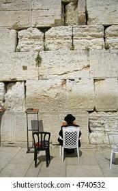 Hasidic jews at the wailing western wall, jerusalem, israel
