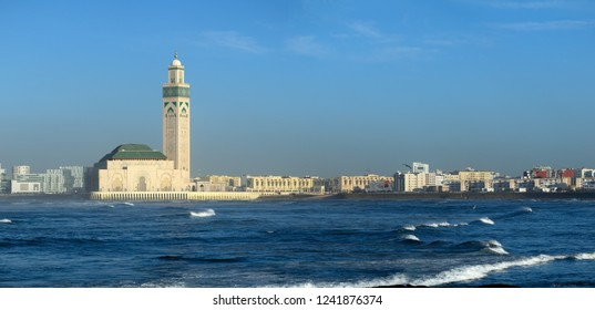 Hassan II mosque in Casablanca and Atlantic ocean waves at sunset, Morocco, panorama