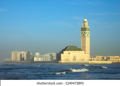 Hassan II mosque in Casablanca and Atlantic ocean waves at sunset, Morocco
