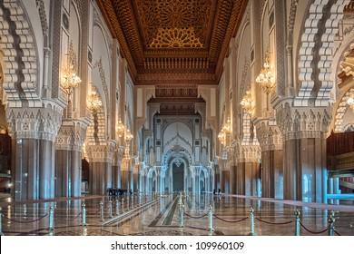 Hassan II Mosque interior corridor with columns in Casablanca Morocco. Arabic arches, ornaments, chandelier and lighting.