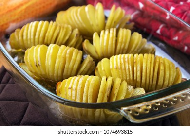 Hasselback potaoes in glass oven dish closeup