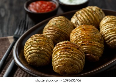 Hasselback potatoes baked with garlic and herbs in oven