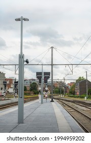 Hasselt, Limburg - Belgium - 06.20.2021. Empty platform at the station. Red signal semaphore lamp post and reproducers