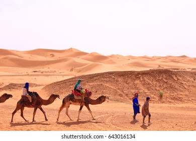 Hassilabied, Morocco - MAR 02th, 2017: People are taking camel in the sahara desert