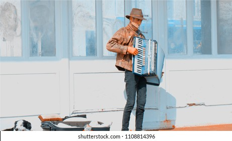 Hasting/ England April 2017 : A street musician showed his music to tourists. It made the lively ambiance around on sunny day.