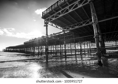 Hastings, East Sussex, England - 11.30.2017 Architecture: Black & White image of the metal structural supports for Hastings Pier