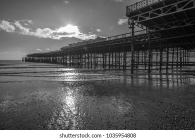 Hastings, East Sussex, England - 11.30.2017 Black & white image of Hastings Pier at low tide.