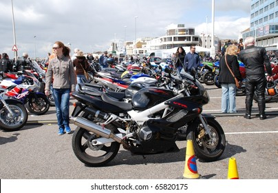 HASTINGS, ENGLAND - MAY 3: Motorcycles parked on the seafront during the May Day biker rally on May 3, 2010 at Hastings, East Sussex. The annual event attracts large numbers of bikers from the South.
