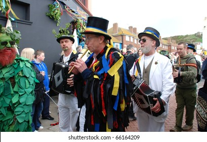 HASTINGS, ENGLAND - MAY 3: Musicians perform during the parade at the annual Jack In The Green festival on May 3, 2010 at Hastings, East Sussex. The event marks the May Day public holiday.