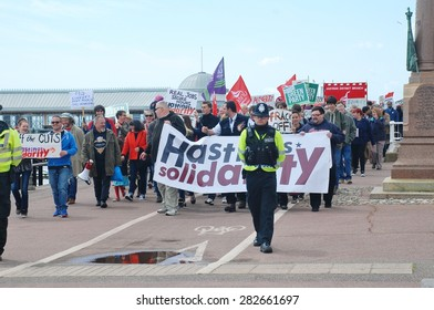 HASTINGS, ENGLAND - MAY 30, 2015: Protestors take part in a march along the seafront to demonstrate against austerity measures and Government cutbacks after the Conservatives won the General Election.