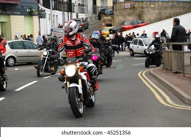 HASTINGS, ENGLAND - MAY 5: Motorcyclists ride along the seafront at a May Day bikers rally on May 5, 2009 in Hastings, Sussex. The annual event attracts thousands of motorcyclists.