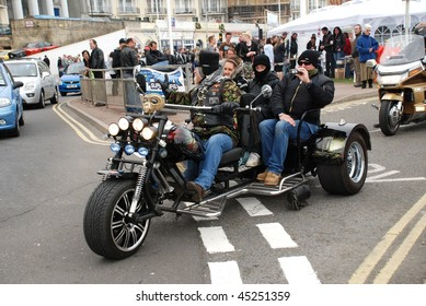 HASTINGS, ENGLAND - MAY 5: A three wheeled motorcycle sets off along the seafront at a May Day bikers rally on May 5, 2009 in Hastings, Sussex. The annual event attracts thousands of motorcyclists.