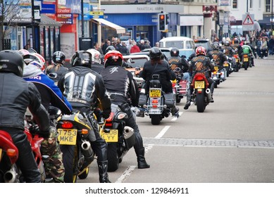 HASTINGS, ENGLAND - MAY 7: Motorcyclists ride through the streets during the annual May Day motorcycle rally on May 7, 2012 at Hastings, East Sussex. The event attracts thousands of riders each year.