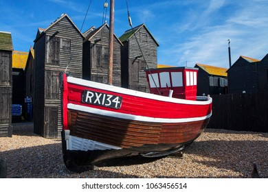 HASTINGS, UK - APRIL 5th, 2018: Boats and net shops in  Hastings, East Sussex. Traditional storage buildings of the Hastings fishing fleet were used in the past to store nets, ropes and sails.
