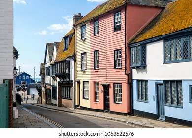 HASTINGS, UK - APRIL 5th, 2018: View of street in seaside town of Hastings with traditional house.  Hastings is a historic town known for the 1066 Battle of Hastings.
