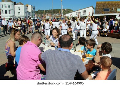 Hastings,East Sussex/UK 05/06/18 A beautiful May Bank Holiday weekend 2018 and families are able to enjoy their fish and chips on the seafront whilst being entertained by Morris dancers