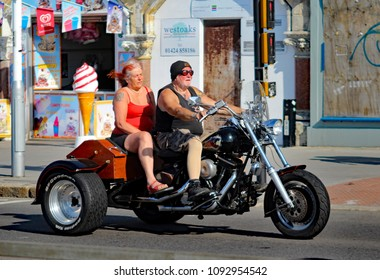 Hastings,East Sussex/UK 07/05/18 Bike 1066 the annual May Day bike run to Hastings. A motor trike with Dennis The Menace picture and pillion passenger arrives to join thousands of other motorbikes