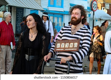 Hastings,East Sussex/UK 08-02-18 Hastings pram race 2018. Sirius Black  is proudly carrying his Harry Potter Prisoner of Azkaban board around before the race.