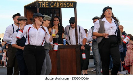 """Hastings,East Sussex/UK 08-02-18 Hastings pram race 2018. One of Hastings most entertaining and colourful free events. Here a Peaky Blinders pub themed """"pram"""" makes its way along the seafront"""