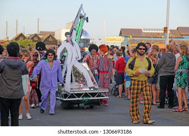 Hastings,East Sussex/UK 08-02-18 Hastings pram race 2018. An entertaining and colourful free event. A team with a Saturday Night Fever theme are pictured on the seafront