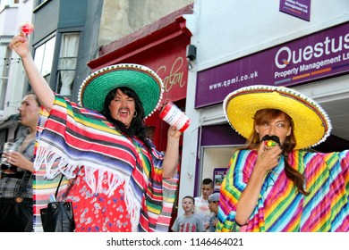 Hastings,East Sussex/UK 08-05-15 A young woman dressed as a Mexican girl madly shaking her rattle and charity collection tin at the annual pram race (2015)