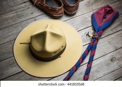 hat of boy scout and accessories on wooden background