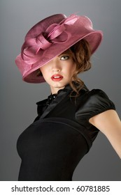 Hat and dress. A portrait of a beautiful young model in a vintage attire.