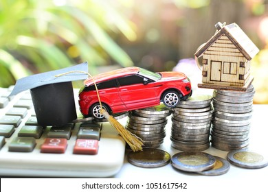 hat education ,car and house model on saving coins money and calculator need basic of life for concept loan and insurance