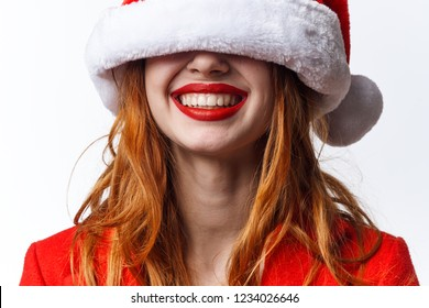 hat in the eyes of a happy woman with a dazzling smile Christmas holiday New year
