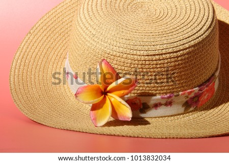 Hat with flower on