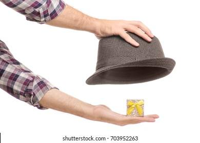 A hat with a gift box of a man's hand on a white background isolation