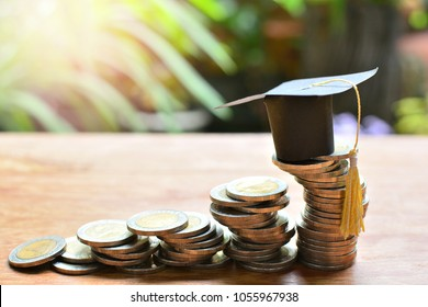 hat graduation model on coins saving for concept investment fund finance and education scholarships