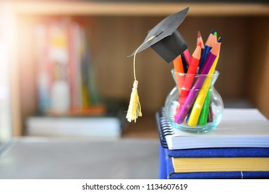 hat graduation model on color pencils for concept education and scholarships
